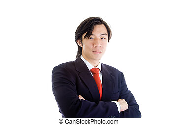Asian man in a suit with crossed arms looking at the camera with a confident expression. Isolated on white