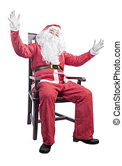 Asian man in Santa costume sitting on a wooden chair