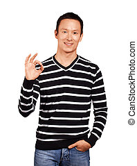 Asian Man In Striped Pullover - Asian man in striped...