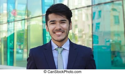 Asian man looking in camera and smiling
