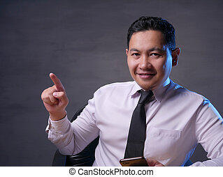 Asian Man Presenting Something on His Side with Copy Space