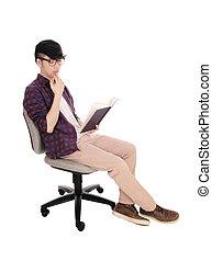 Asian man reading a book.