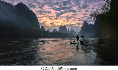 Asian man rowing on wooden boat, A man rows Thai wooden boat...