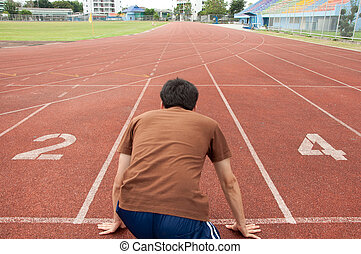 asian man runner on running track
