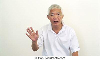 Asian man Senior angry say no - Asian man Senior looks at...