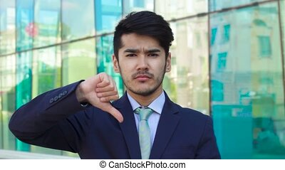 Asian man show Disslike using gesture of hand