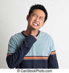 Asian man sore throat