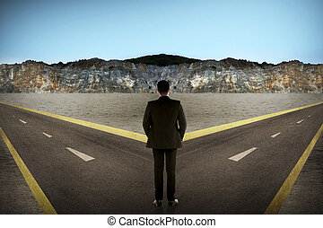 Asian man standing in the middle of cross road