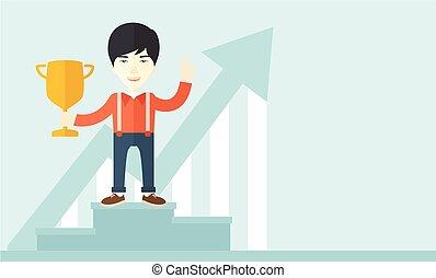 Asian man standing on the winning podium