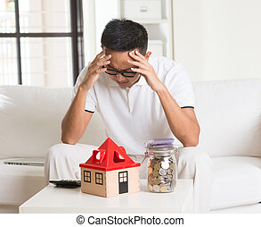 asian man stress on high property price and debts