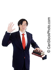 Asian Man Swearing on a Stack of Bibles Isolated White