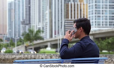 asian man talking mobile telephone