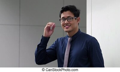 asian man throwing eyeglasses