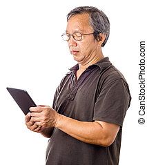 Asian man using tablet