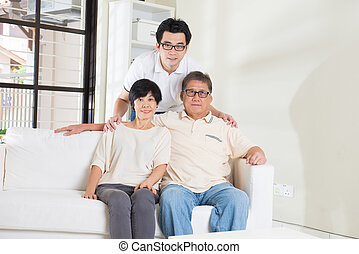 asian man with his parents