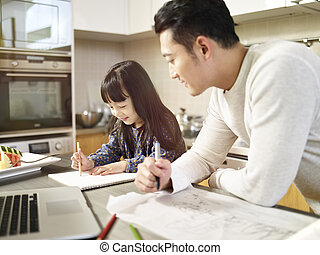 asian man working at home while taking care of daughter