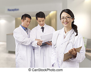 portrait of a young female asian doctor.