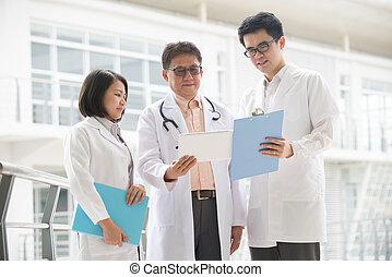 Asian medical team of doctors meeting inside hospital...