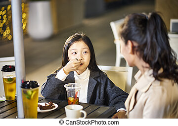 asian mother and daughter having a conversation