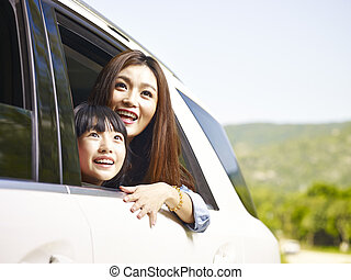 asian mother and daughter on a sightseeing trip