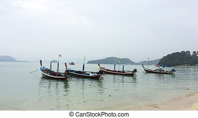 Asian motorboats on a beach