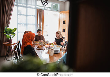 muslim family break fasting together