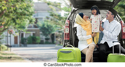 asian muslim family with suitcase prepare to go. concept of family travelling for eid mubarak celebration