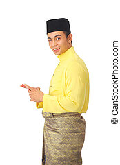Asian muslim male with traditional Malay costume in action...