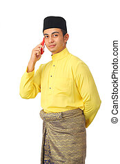Asian muslim male with traditional Malay costume in happy...