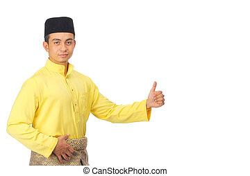 Asian muslim male with traditional Malay costume in present...