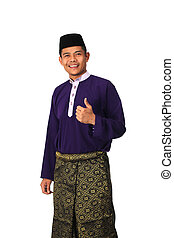 Asian muslim male with traditional Malay costume in thumb up action, Baju Melayu
