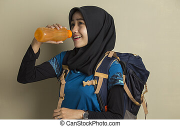 Asian muslim woman drinking water