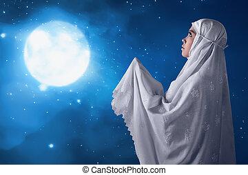 Asian muslim woman pray to god