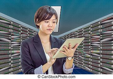Asian network engineer in server room