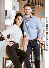 Asian nice female with black long hair and handsome unshaven male i