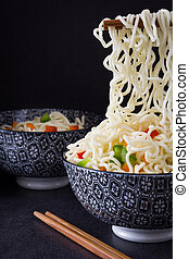 Asian noodles and vegetables.
