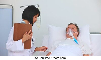 Asian nurse checking installions of a patient's room