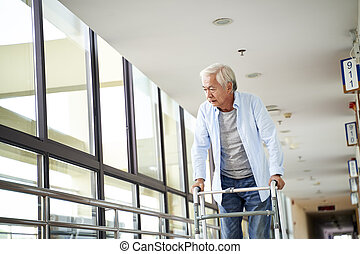 asian old man walking using walker with difficulty in nursing home