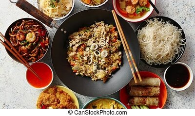 Asian oriental food composition in colorful dishware, served...