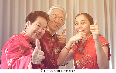 Asian parents give daughter in law thumb up Chinese New Year