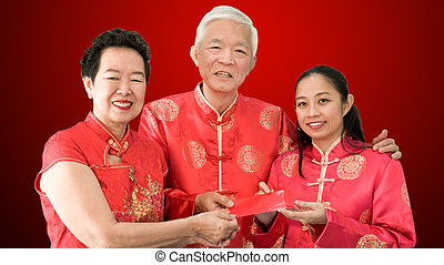 Asian parents give red envelop to daughter Chinese New Year