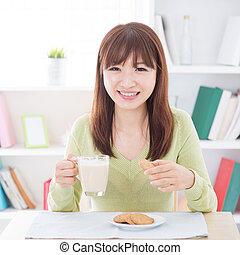 Asian people eating breakfast