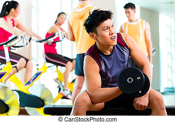 Asian people exercising sport for fitness in gym