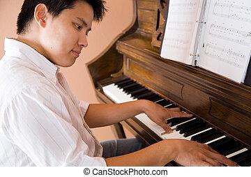 Asian playing piano