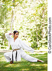Asian practicing karate - A shot of an asian woman...