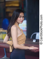 Asian pretty and sexy portrait girl has relaxing at coffee cafe restaurant in the morning.