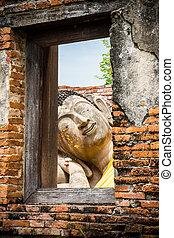 Asian religious art. Ancient sandstone sculpture of Buddha...