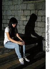 Asian sad woman on street
