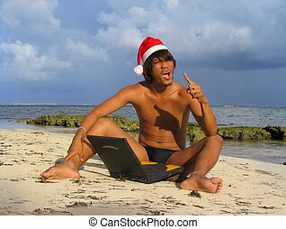 Asian Santa on beach with laptop