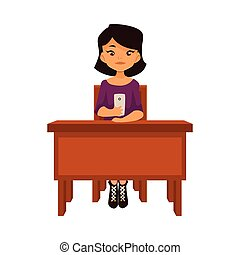 Asian school girl sitting at the desk with a smartphone